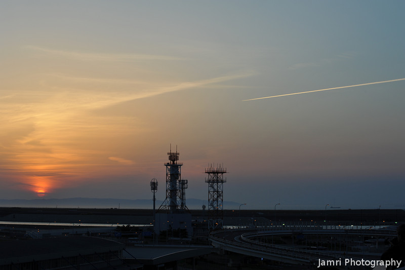 Sunset, Antennae, and Vapour Trail.<br /> From Kansai Airport.