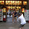 "Capturing a capture.<br /> Some tourists pose for a shot outside the ""Arcade Shrine""."
