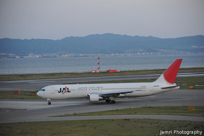 JAL Departing.<br /> After sunset a JAL Boeing 767-346 (Rego: JA8365) departs from Kansai.