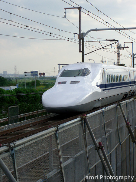 Even Closer.<br /> A 700 series Shinkansen from Hankyu O-Yamazaki Station. This a great spot for seeing the Shinkansen, the lines run right next to the platform for trains bound for Osaka. At this point of the line they're travelling around 180kmh (not up to top speed about ).