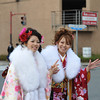 Waving as they pass.<br /> Two young ladies on their way to the Coming of Age Day Ceremony.