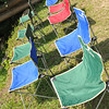 Drying out the chairs.<br /> Chairs from an outdoor eating area, where had dinner on the first night. It had rained in the early hours of the morning.<br /> At Aburamu no sato (Abram's place) near Hida Furukawa, Gifu Prefecture, Japan.