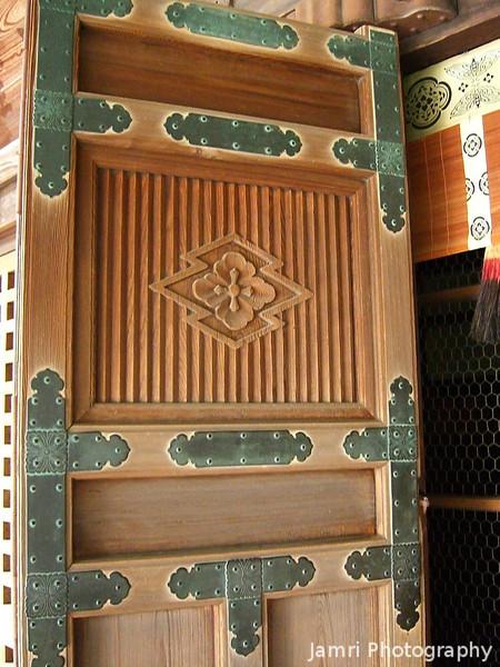 Detail of a door with a cross shaped carving.<br /> At Koryu-ji (Koryu Temple) in Uzumasa, Kyoto.