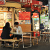 Outdoor Dining.<br /> Outside a Takoyaki (fried savoury dough balls with bits of Octopus in it) shop in downtown Kyoto.