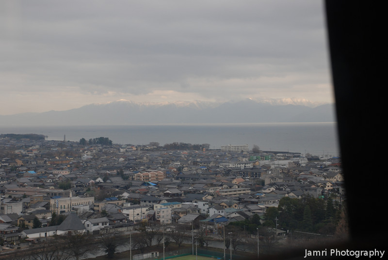 Across Hikone town, Lake Biwa and towards snow capped mountains.<br /> Yes, I've already mentioned it was a cold day!