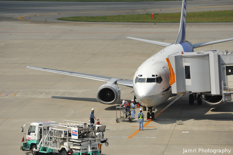 Ground Crew Getting Ready.<br /> For an ANA 737-500.