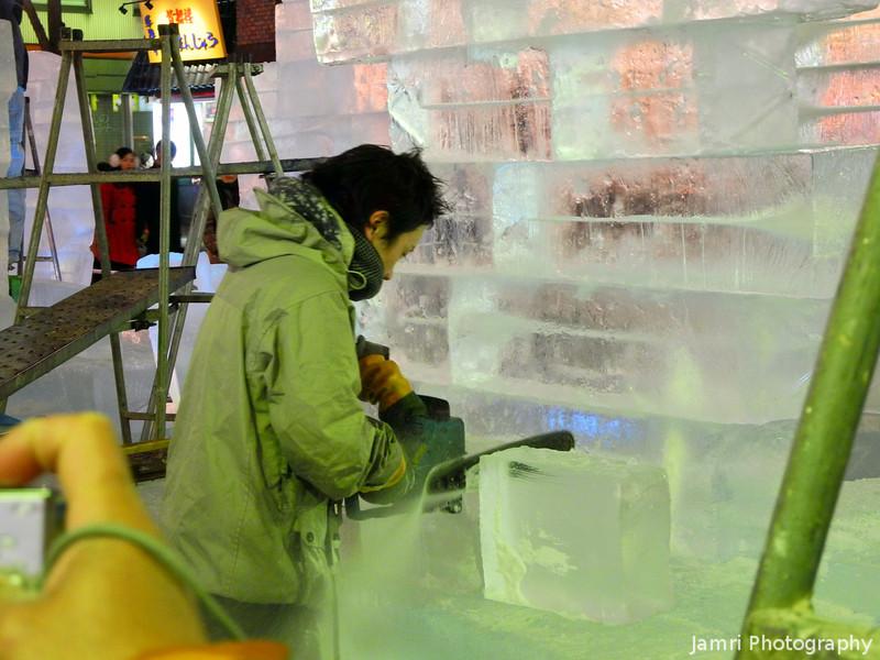 Chainsaw cutting through Ice.