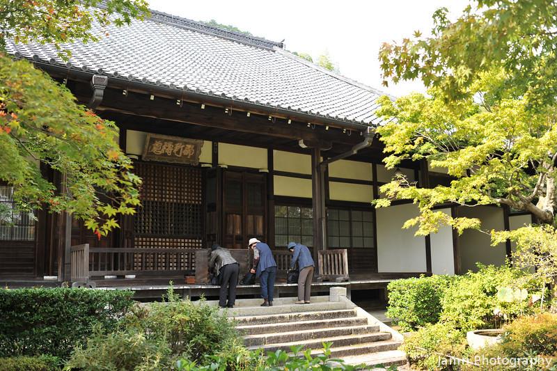 Worshippers at Jojakko-ji (a Buddhist Temple).