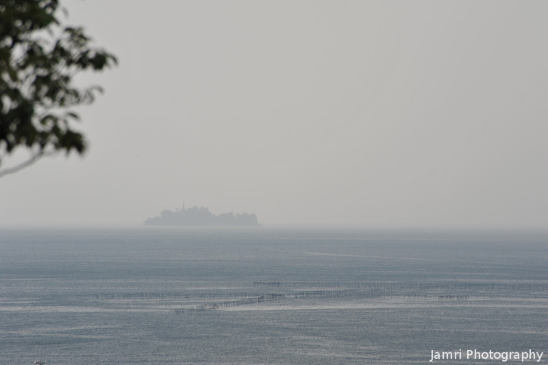 A view of a small island.<br /> On Lake Biwa from the grounds of Hikone-jo.