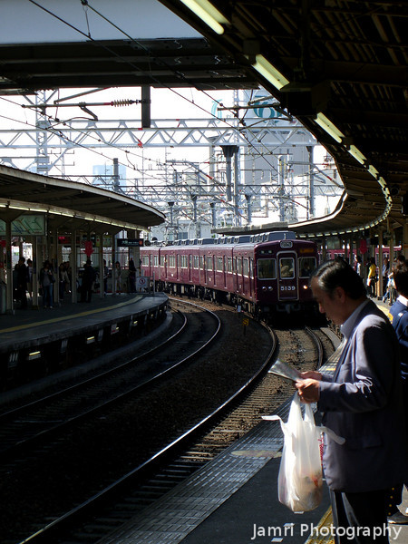 Changing Trains.<br /> Hankyu Juso Station is the place where the three main Hankyu lines (Kobe, Takazuka and Kyoto) meet and where many people change trains. I snapped this as we were waiting to change on to the Takazuka line from the Kyoto line.