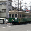 Tram on the road, in Uzumasa, Kyoto.