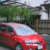 A Red Car.<br /> Note Film Shot: Nikon F80 + Nikkor AF 50 f/1.8 + Fujicolor PRO400