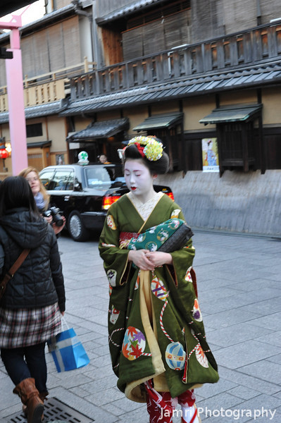Almost!<br /> I hardly had time to react and push the shutter when she came by, they move so fast. Yes she is the real deal, not a tourist paying for the privileged to dress up like one. The tourist tend to stop to pose a lot, real Maiko (or Apprentice Geisha) are always in a hurry, unless they've been paid to pose!
