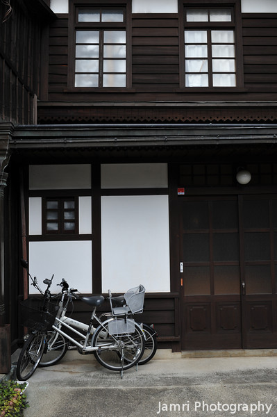 "Traditional house and bicycles.<br /> In Takayama's ""Little Kyoto""."