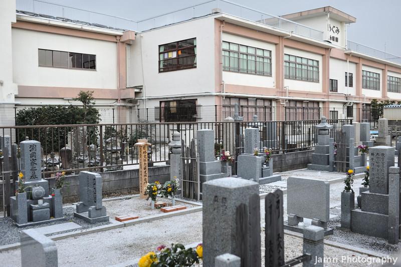 Graveyard (foreground), Megumi Kindergarten (rear).
