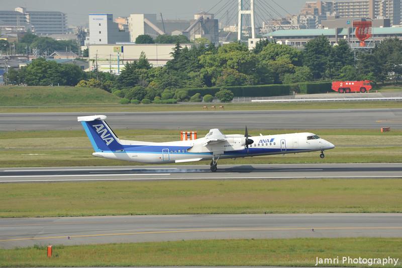 Touch Down.<br /> An ANA De Havilland Canada DHC-8-402Q Dash 8 at Itami Airport.