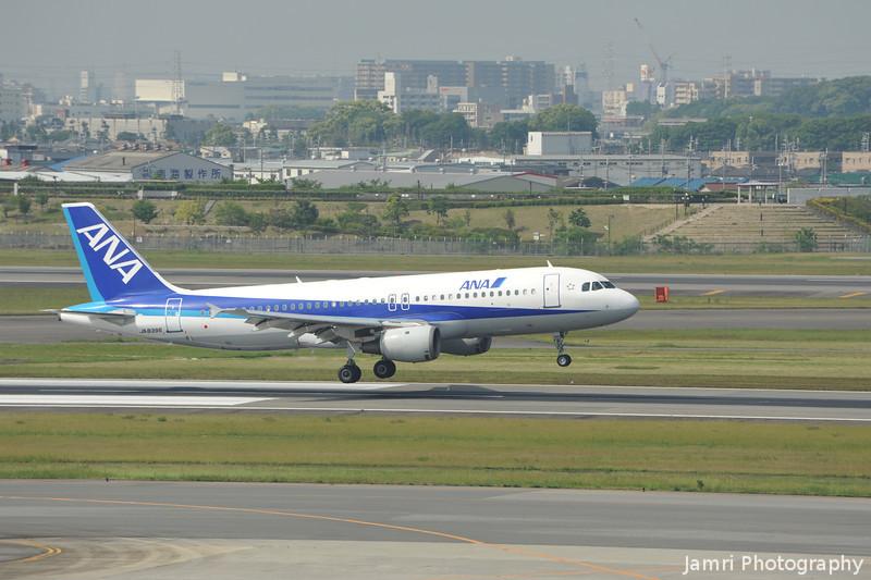 ANA Airbus A320 landing at Itami.