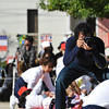 The Pro.<br /> In Japan people take the sports carnivals and getting good photos very seriously, even for a kindergarten sports carnival there's a professional photographer capturing all the action.