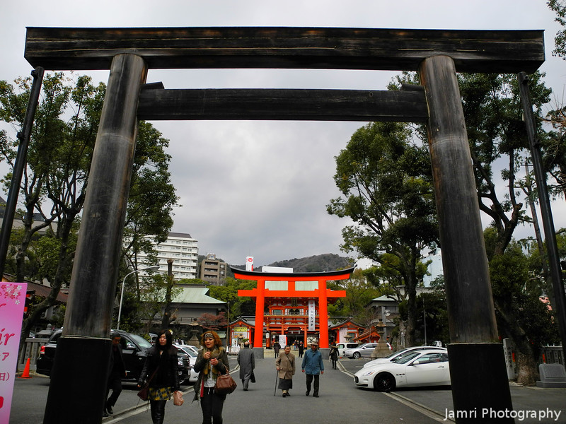 At the outer gate.<br /> Of Ikuta Shrine in Kobe. This outer gate is the more ancient style, this shrine is believed to be one of the oldest in Japan.