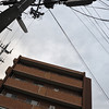 Framing the Chocolate Mansion.<br /> Wires are everywhere in Japan, some time you can use them as elements in your shots.