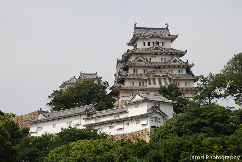 "A View of Himeji-jo.<br /> Considered the best castle in Japan, Himeji-jo is only one of ten still remaining in the ""original"" wooden form. Within that ten it's only one of four designated as national treasures. It's also a UNESCO World Heritage Site."