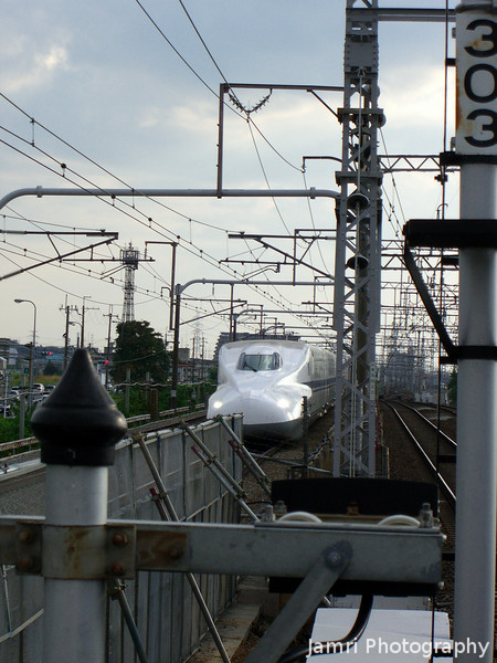 "Close to a bullet.<br /> An approaching N700 series Shinkansen (also know in Japan as ""Super Express"", outside of Japan as ""Bullet Trains"") at the point in the line where it runs next to the Hankyu line at Hankyu O-Yamazaki Station."