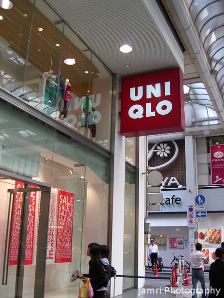 """Uniqlo Shinsaibashi.<br /> Uniqlo (pronounced """"Yunikuro"""") is a clothes shop which specialises in low cost, yet reasonably fashionable clothing. Uniqlo is  one of the few business booming at the moment."""
