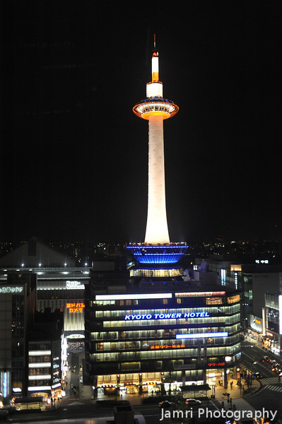 Kyoto Tower at Night.<br /> Hand held shot from the Kyoto Station Sky Walk. After deserts at Holly's we brought Mick to the Sky Walk to see the night view of Kyoto.