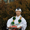 Lady in Traditional Shintoist Clothing.<br /> Handing out advertising flyers for a festival at a shrine.