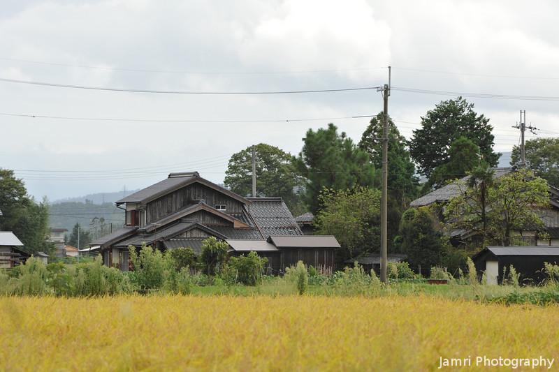 An old house across a field.