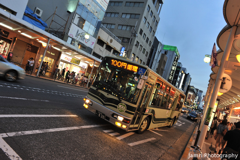 100yen Bus.<br /> This bus only charges a flat 100yen fare, I'm not sure how far it goes though.
