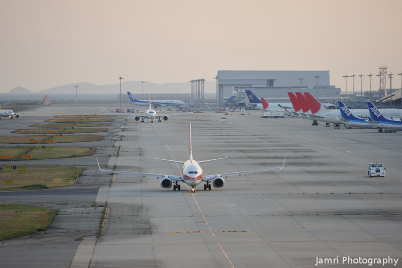 Moving out.<br /> A couple of planes heading out to take off from Kansai Airport.