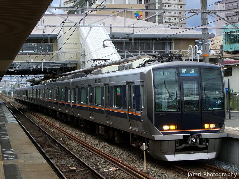 Commuter Train at JR Nagaokakyo Station.<br /> Heading towards Kyoto.