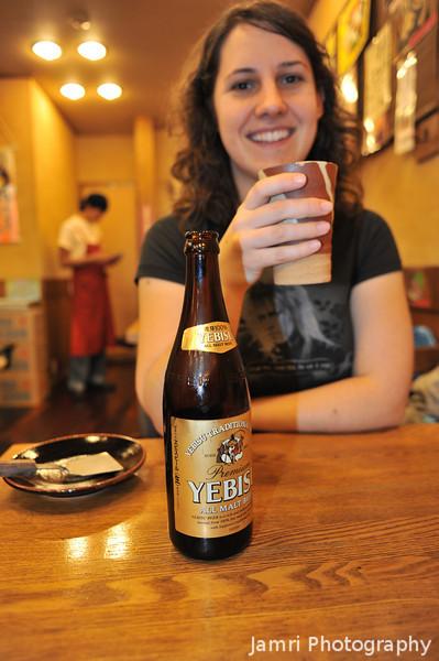 Kanpai! (Cheers!)<br /> Melissa samples a Yebisu beer from a ceramic cup at a Hiroshima-yaki restaurant in Hiroshima.