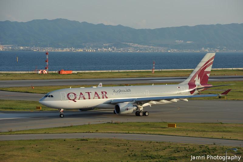 QATAR Airways.<br /> At Kansai Airport.<br /> An Airbus A330-203, Rego: A7-ACE