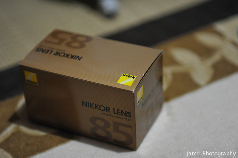 The Obligatory Box Shot.<br /> It's a little late... But, here it is, the box shot for the 85mm f/1.8. Which I picked up in Hong Kong airport for 20% less than what they sell for in Japan. Although Nikon is a Japanese brand this lens is made in Thailand, I wonder if the made in Japan lenses are cheaper in Hong Kong???