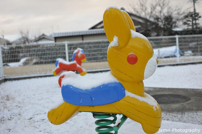 Snow coated playground.