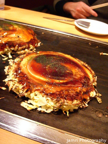 The Completed Okonomi-yaki.<br /> A type of Japanese savoury pancake.