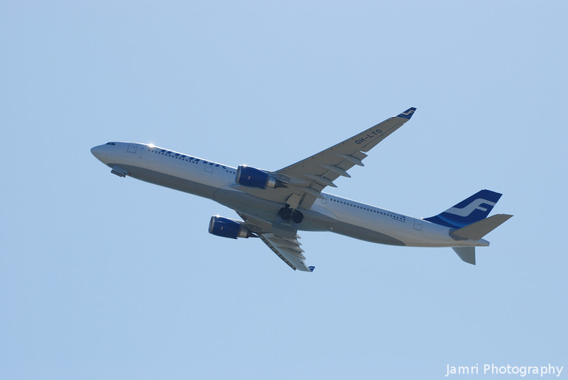 Finnair Flying on by.<br /> A Finnair A330-300 shortly after take off from Kansai Airport.