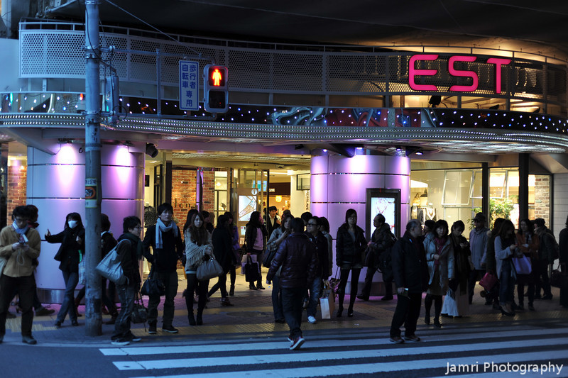Street Life in Osaka.<br /> This is the first photo from a number taken in the evening Osaka on March 27th 2011. As most of you are aware that in the North East of Honshu Island there has been the triple Earthquake/Tsunami/Nuclear disaster. Well here in Kansai, it is business as usual, we are not having any power shortages like in Tokyo. What I've noticed is that there is a distinct lake of foreigners in Kansai at the moment, maybe scared off from Japan by things happening further North. I would say why don't you come to Kansai? There is plenty to see here. Please check your travel insurance, etc, to make sure they are covering you for Japan at this time.<br /> This series from Osaka was photographed with my trusty Nikon D700 and AF Nikkor 50 f/1.8D. It going to be followed with a series from Kyoto on the following night using the same gear.