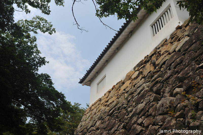 Stone Wall and Small Building.