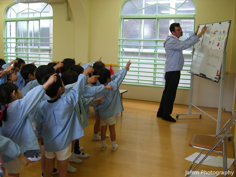 Air writing.<br /> Here the children are following my writing of a letter of the Alphabet on the board with their pointer fingers.<br /> Photo by Mitsuko Fujita.