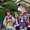 An American and his fan club!<br /> Nagaokakyo is a sister city of Arlington. So in the Garasha Matsuri some Americans (probably ALTs) march with local students dressed American flag hats.