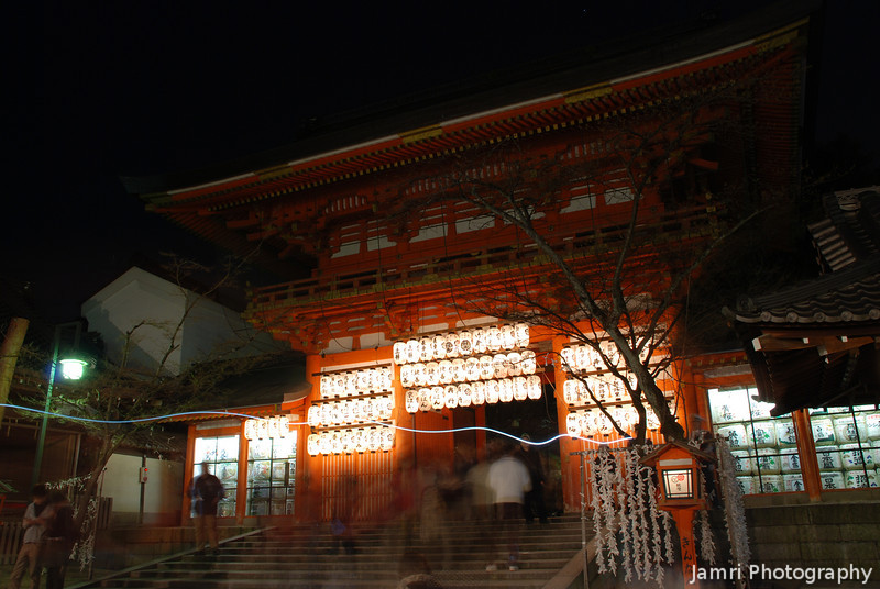 Through the Shrine Gate.<br /> That line like lightening is caused by someone walking past talking on a mobile phone with the screen lit up. At Yasaka Shrine in Gion, Kyoto.
