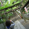 Capturing a capture.<br /> My sister Melissa tries out her new camera at Nagaoka Tenmangu Shrine.
