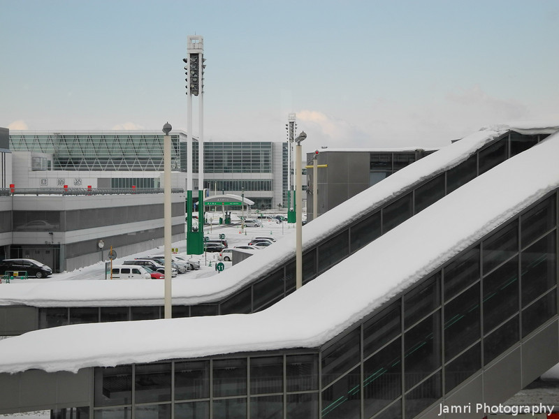A Couple of Snow Covered Stairways.<br /> At New Chitose Airport.