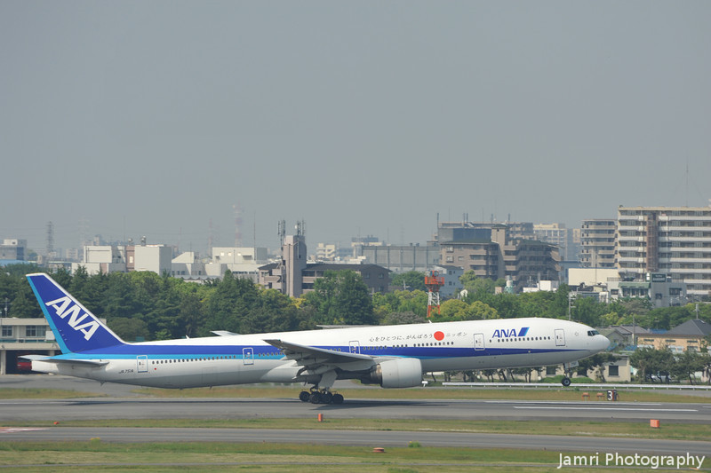 An ANA Boeing 777-300 Lifts off from Itami.