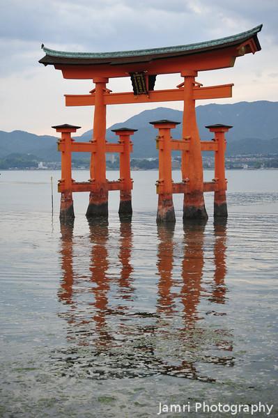 Reflections of the Torii.<br /> At Itsukushima Shrine on Miyajima, Hiroshima Prefecture.