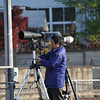 Making Adjustments.<br /> One of the railfans adjusts one of his cameras.