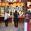Worshipping at Shrine.<br /> Some people gather to pray at a Shinto Shrine in an arcade in Kawaramachi, Kyoto.